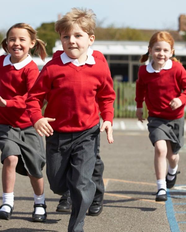 school kids running - uniform
